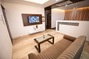 Living room with bedroom & bath - Chola Serviced Apartment
